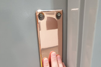 An activated copper doorplate at Swinburne University.