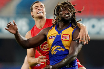 Jarrod Witts, left, and Nic Naitanui, right, clash.