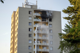 Firefighters battle a fire in an apartment building in Bohumin, north-eastern Czech Republic, in which at least 11 people have been killed.