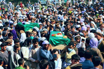 Afghans carry the body of civilians killed during fighting between the Taliban and security forces, during their funeral in Badakhshan province on Sunday.