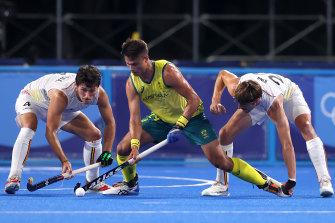 Belgium's Arthur Van Doren and Antoine Sylvain T Kina battle for possession with Australia's Tim Brand.