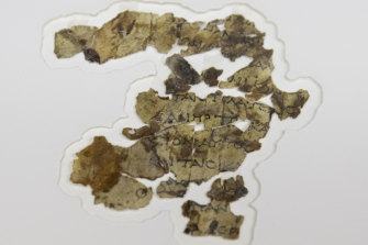 The fragments of parchment bear lines of Greek text.