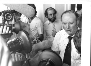 State Secretary of the ARU Jim Walshe, beseiged by media after his members voted to stay out on strike at a meeting held at Parramatta Town Hall. February 17, 1982.