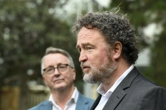 Professor Ben Cowie (right) speaks on Sunday as Health Minister Martin Foley looks on.