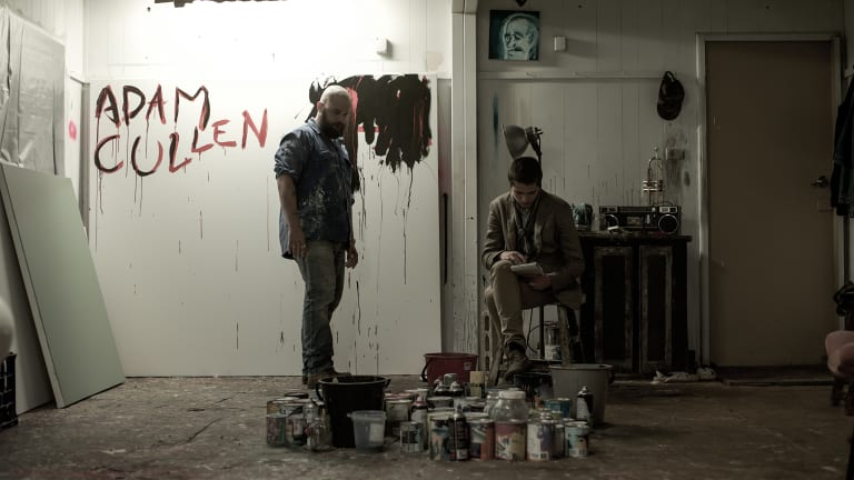 Adam Cullen (Daniel Henshall) and Erik Jensen (Toby Wallace) in Cullen's studio in a scene from <i>Acute Misfortune</i>.