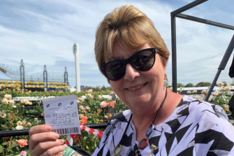 Cath Hood with her winning ticket.
