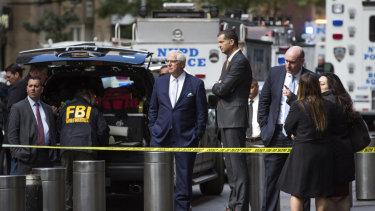 NYPD Deputy Commissioner of Intelligence & Counterterrorism John Miller, centre, arrives outside Time Warner Centre in New York.