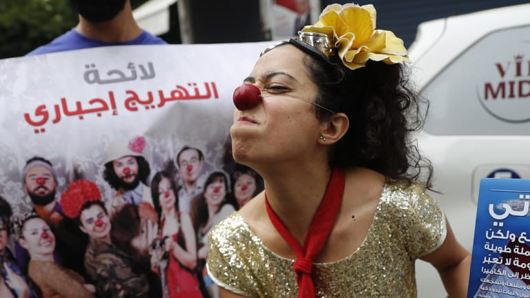 A member of the clown troupe, Clown Me In, pokes fun at Lebanon's first national elections in nine years, outside a ballot station in Beirut on Sunday.