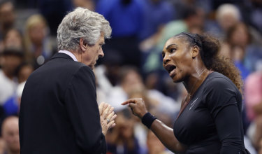 Serena Williams, right, talks with referee Brian Earley during the women's final of the US Open.