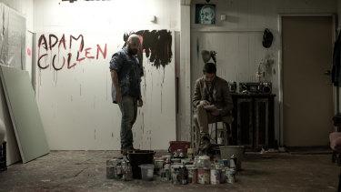 Adam Cullen (Daniel Henshall) and Erik Jensen (Toby Wallace) in Cullen's studio in a scene from <i>Acute Misfortune</i>.