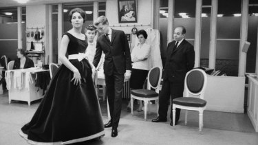 Farah Pahlavi with Yves Saint Laurent in Paris, 1959.