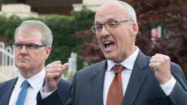 Luke Foley, flanked by Michael Daley, making a transport policy announcement on Thursday morning, before resigning in the evening.