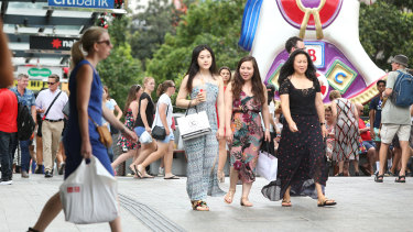 Christmas shoppers in Brisbane's Queen Street Mall.