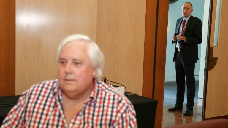 Ben Oquist hovers at a joint Clive Palmer-John Hewson press conference in 2014.
