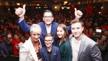 Sweet victory: Daniel Andrews and his family on Saturday night.