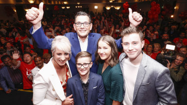 Premier Daniel Andrews (top) poses for a photo with his family during the Labor Party celebrations