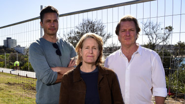 Disability advocate Adam Long (left), artist Sally Kiddal (centre) and founding director of Sculpture by the Sea David Handley in front of construction work for the new path at Marks Park in July.