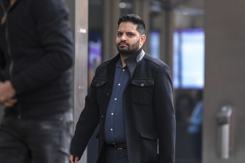 Rajesh Kumar outside court in Melbourne on 25th June 2020. Rajesh Kumar and Harsimrat Singh, of Point Cook in Melbourne's west, received 16 charges and nine charges, respectively, for using corrupt conduct information for betting purposes and proceeds of crime offences. Both deny the charges.