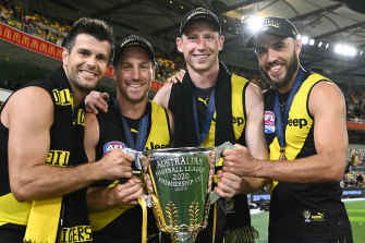 (L-R) Trent Cotchin, Kane Lambert, Dylan Grimes and Shane Edwards celebrate with the 2020 premiership cup.