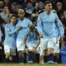 Kompany strike leaves Manchester City one win from EPL title