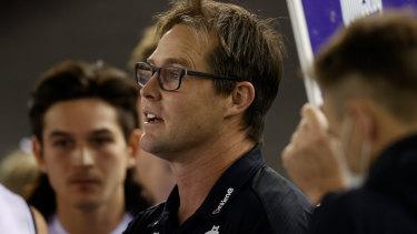 Carlton coach David Teague addresses his players against the Saints.