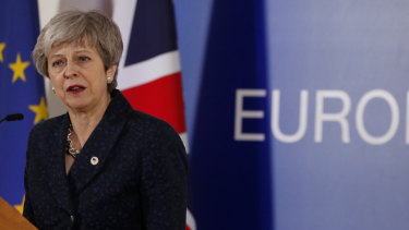 British Prime Minister Theresa May speaks during a media conference at an EU summit in Brussels.