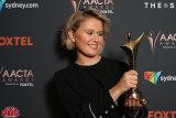 Eliza Scanlen with her AACTA Award for best actress for her role in Babyteeth.
