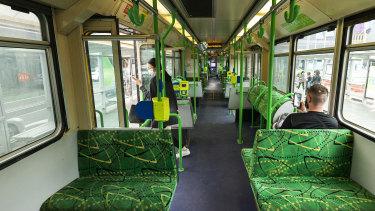 A near empty tram travels along St Kilda Road.
