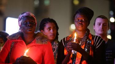 Mourners at Sunday's vigil.