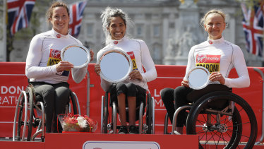 Madison de Rozario of Australia placed first, centre, Tatyana McFadden of USA placed second, left, and Susannah Scaroni of USA placed third.