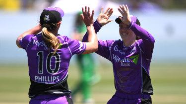 Hurricanes Meg Phillips and Sasha Moloney celebrate their win.
