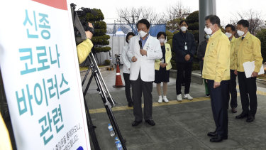 South Korean President Moon Jae-in is briefed by Daegu Medical Centre President You Wansik in Daegu, South Korea.