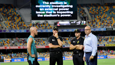 Blackout: Chris Lynn of the Heat talks to match officials after play was abandoned at the Gabba in the result that ultimately cost the Thunder.