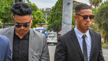 Wests Tigers player Michael Chee Kam, right, and his younger brother Livingston Chee Kam leave Waverley Local Court following a court appearance in February.