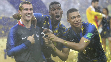 From left: Antoine Griezmann, Paul Pogba and Kylian Mbappe celebrate their World Cup win.