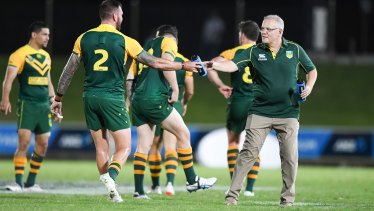 Prime time: Scott Morrison hands out water during the PM's XIII game in Fiji recently.
