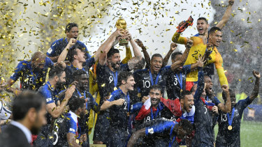 France's Olivier Giroud lifts the trophy after France defeated Croatia 4-2.