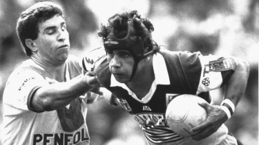Brisbane Broncos player Steve Renouf  (right) fends off a St George defender during his 90-metre try in the 1992 rugby league grand final at the Sydney Football Stadium.