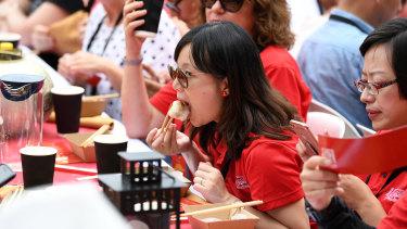 Mouthful: Dumpling fans take part at Darling Harbour.