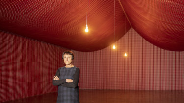 Cornelia Parker inside The War Room, constructed from the offcuts of remembrance poppies.