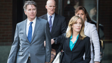 Actress Felicity Huffman exits federal court in Boston on Wednesday.