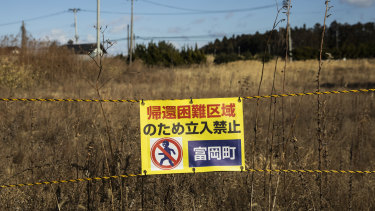 """A sign reads """"Do not enter"""" along Route 6 in Tomioka near the Fukushima Daiichi nuclear plant."""