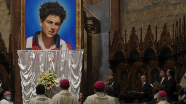 An image of Carlo Acutis is unveiled during his beatification ceremony celebrated by Cardinal Agostino Vallini in the St Francis Basilica, in Assisi, Italy.