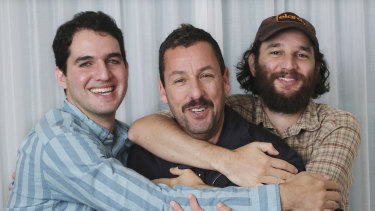 Adam Sandler, centre, with co-directors Benny Safdie, left, and his brother Josh at the International Film Festival in Toronto.