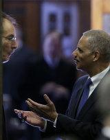 Then attorney-general Eric Holder talks with US District Judge Robert Pratt, left, in Des Moines, Iowa in 2012.