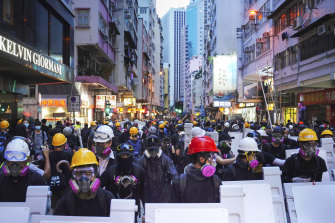 Protesters with protective gear gather in Central, the main business district in Hong Kong, on Sunday.