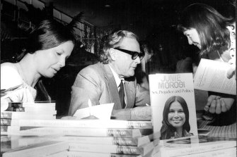 """""""Juni Morosi and Dr. Cairns autograph copies of their books for Shoppers at Roselands today."""" November 24, 1975"""