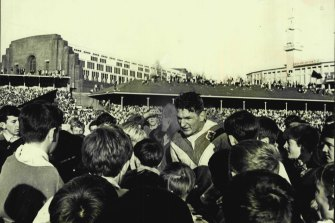 Provan stands all among St George fans after the 1965 grand final win at the Sydney Cricket Ground.