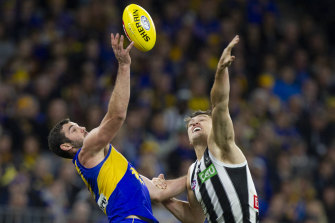 Eagle Jack Darling and Collingwood's Darcy Moore. Moore suffered a hamstring injury in first term.