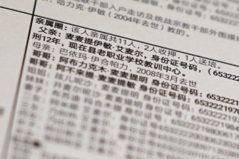 "Details from a leaked database that offers an insight into how Chinese officials decide who to put into detention camps. The text reads: ""Family circle: Total relatives 11, 2 imprisoned, 1 sent to training, Father: Memtimin Emer ... sentenced to 12 years [and] is now in the training centre at the old vocational school."""